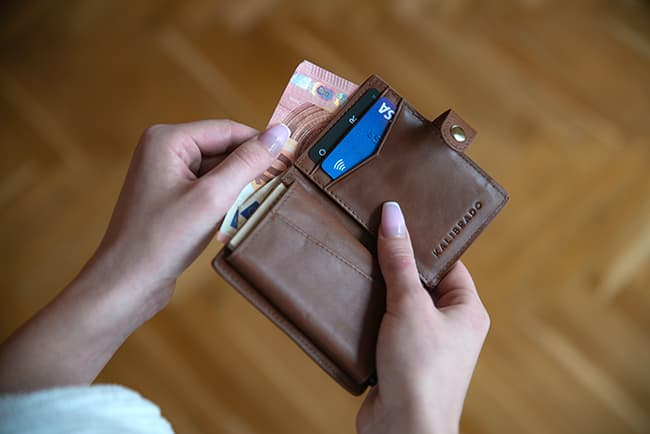 Woman prepared to make a purchase with her credit card.